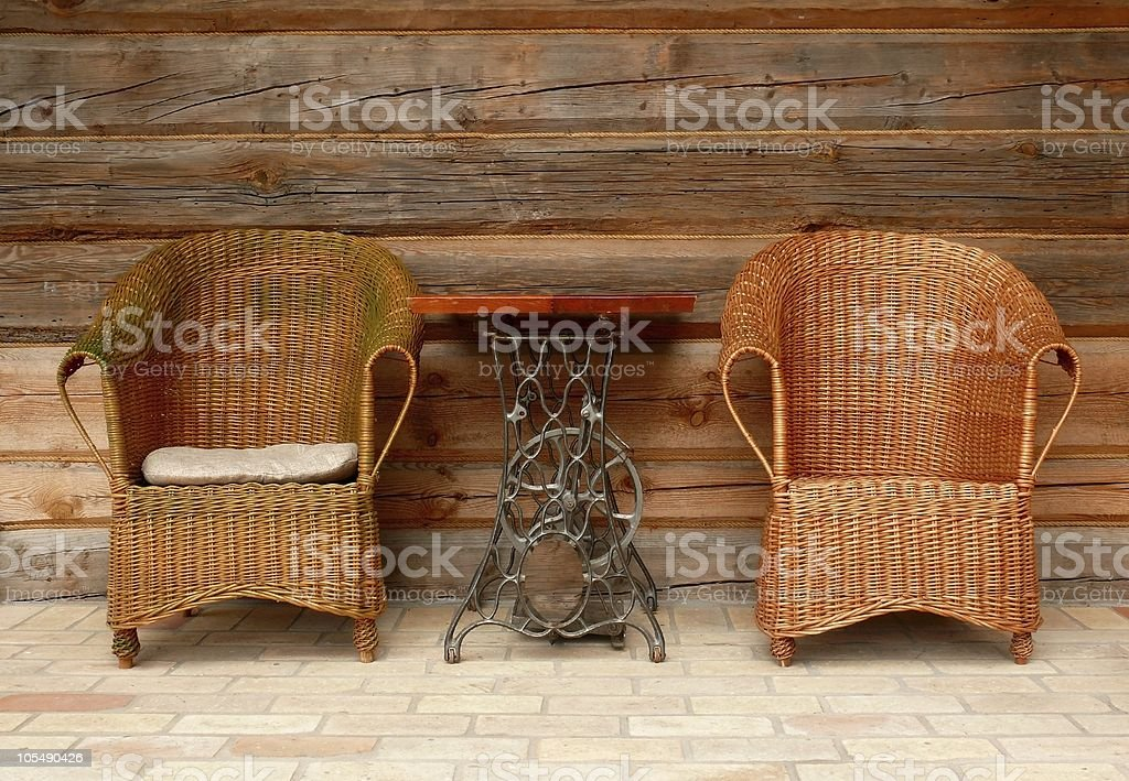 Wicker chairs and the sophisticated table royalty-free stock photo