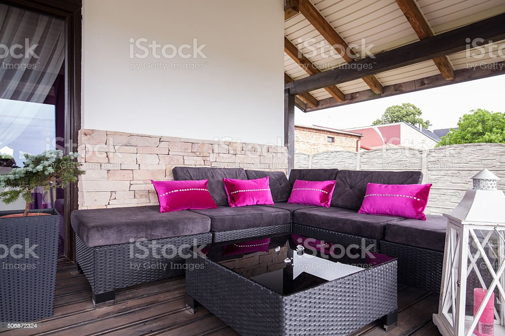 Wicker couch on the terrace stock photo