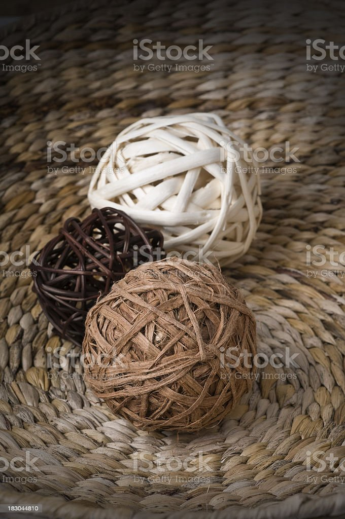 wicker decorative balls over vegetal texture royalty-free stock photo