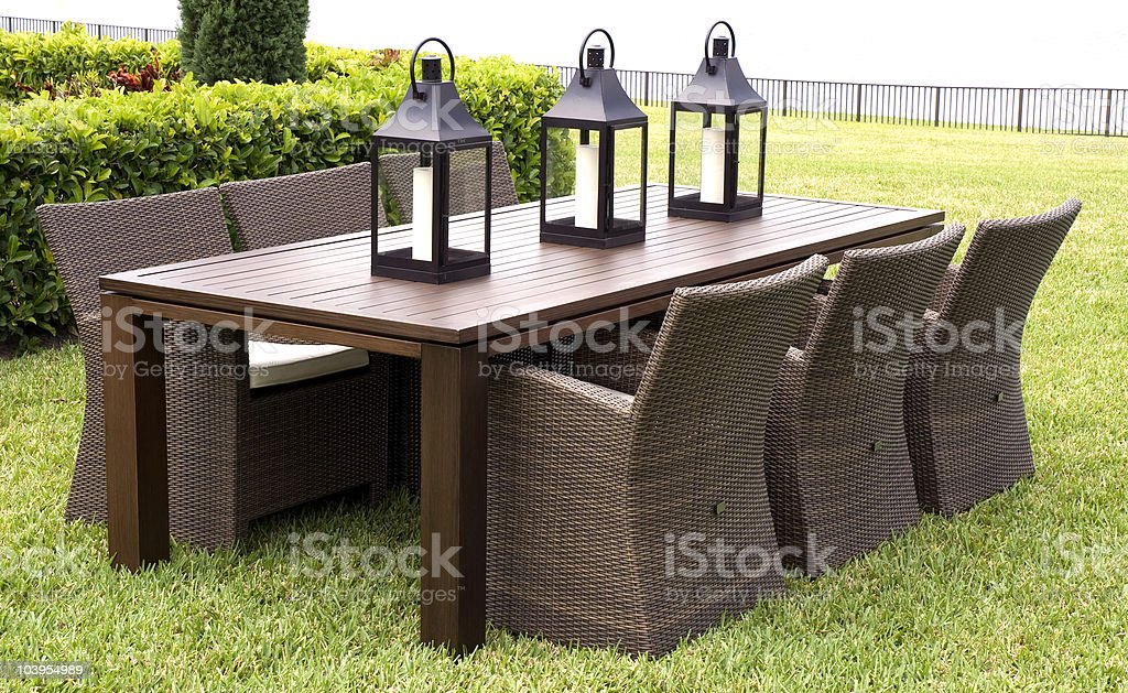 Wicker Dining Set With Lanterns In The Grass royalty-free stock photo