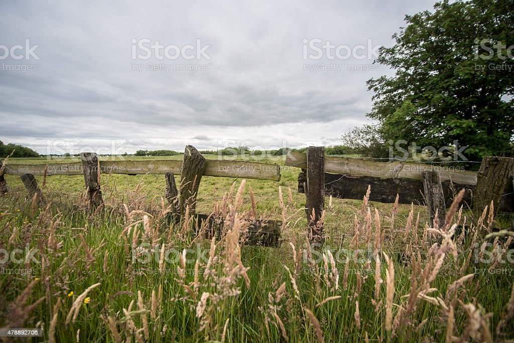 Wicker fence with wood and barbed wire stock photo