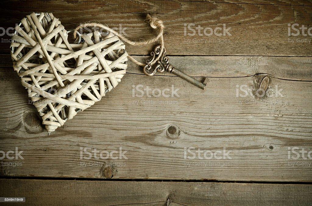 wicker heart handmade with the key stock photo