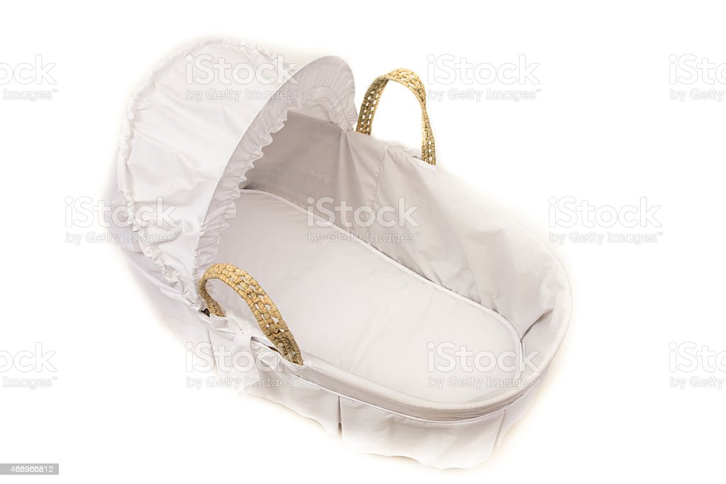 Wicker Moses basket with white cover and hood stock photo