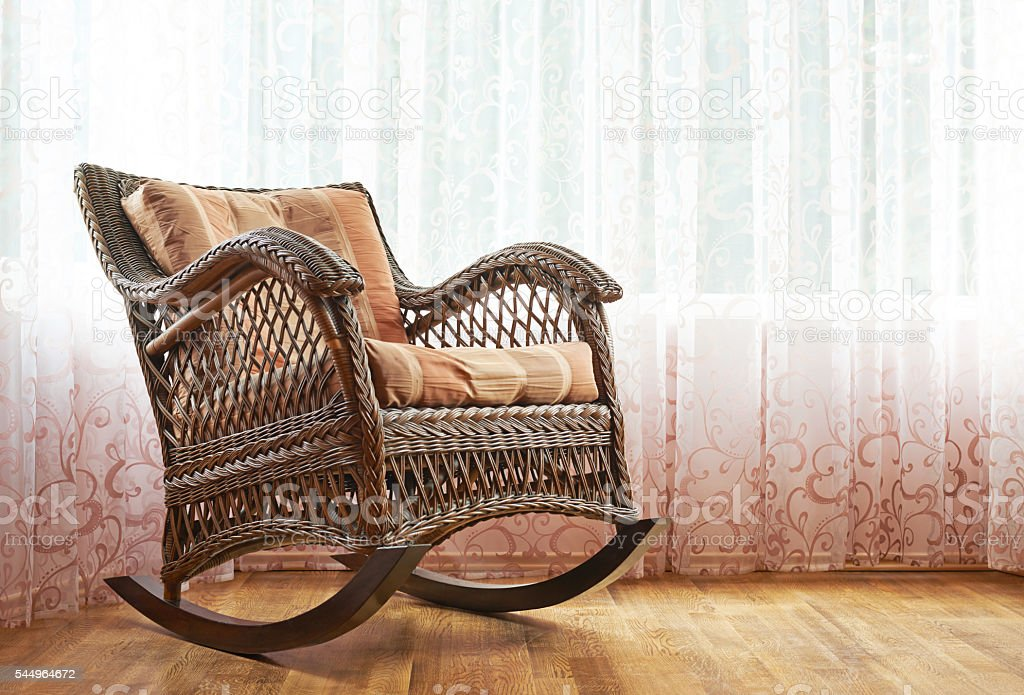 Wicker rocking chair composition stock photo