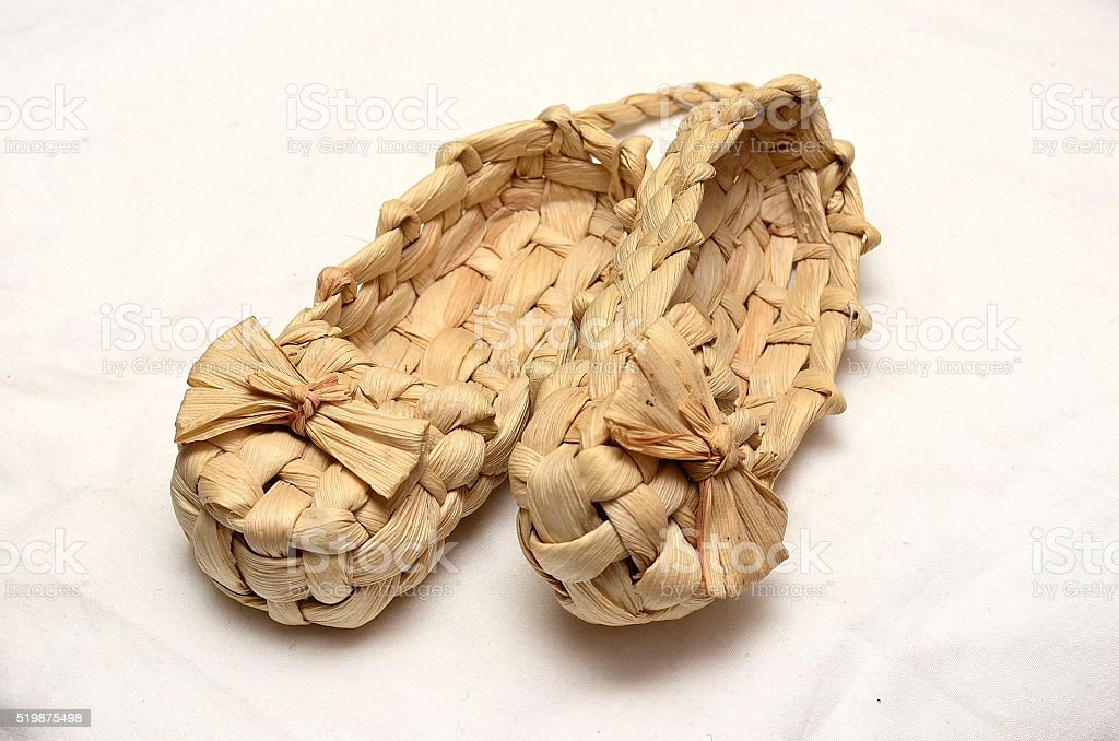 Wicker shoes of bast stock photo