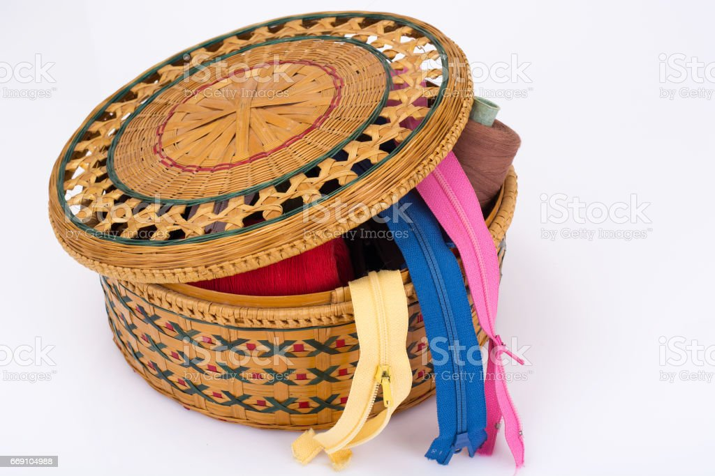 Wicker straw box for sewing accessories stock photo