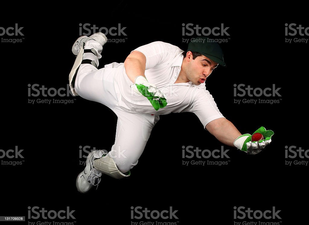 Wicketkeeper Dives stock photo