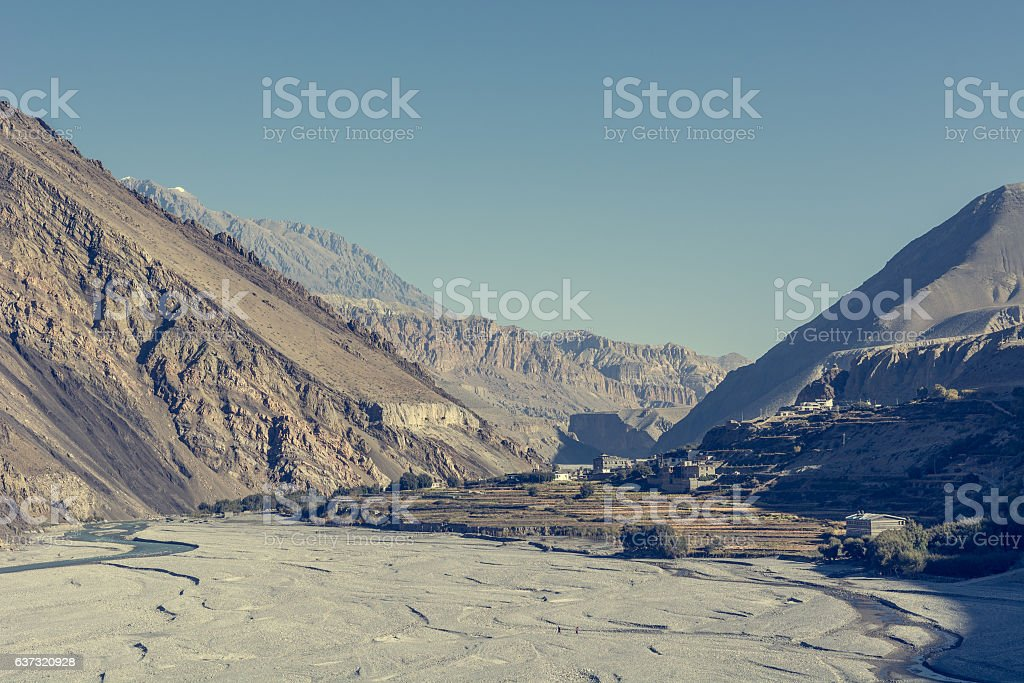 Wide and almost dry river bed. stock photo