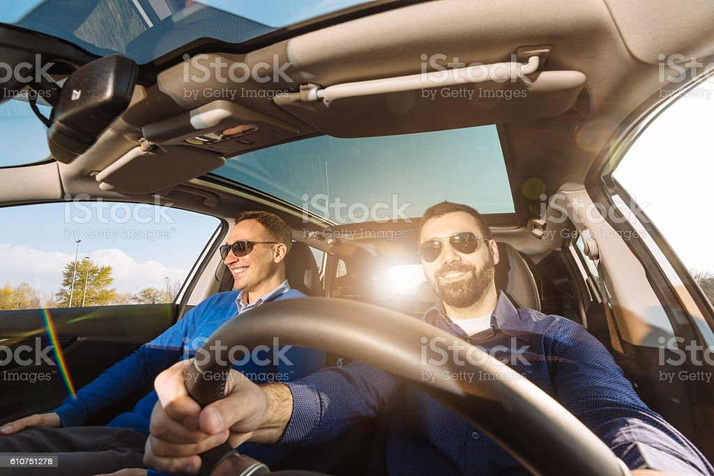 Wide angle image of two adults in car stock photo