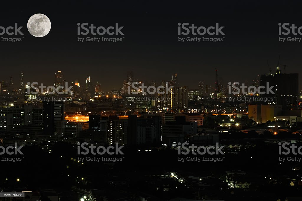 Wide angle of city scape at night scene with supermoon stock photo