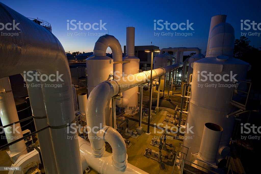 Wide angle photo of a water purification plant at dusk royalty-free stock photo