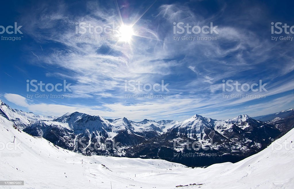 Wide angle photograph of snowy mountains stock photo