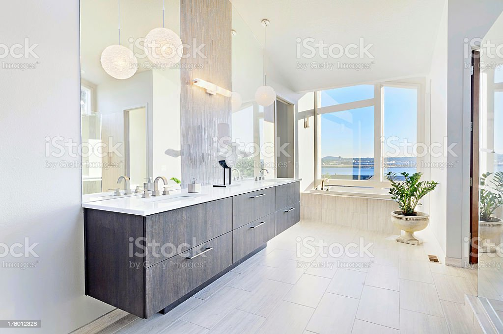 Wide angle shot of a beautiful bathroom in a new home stock photo