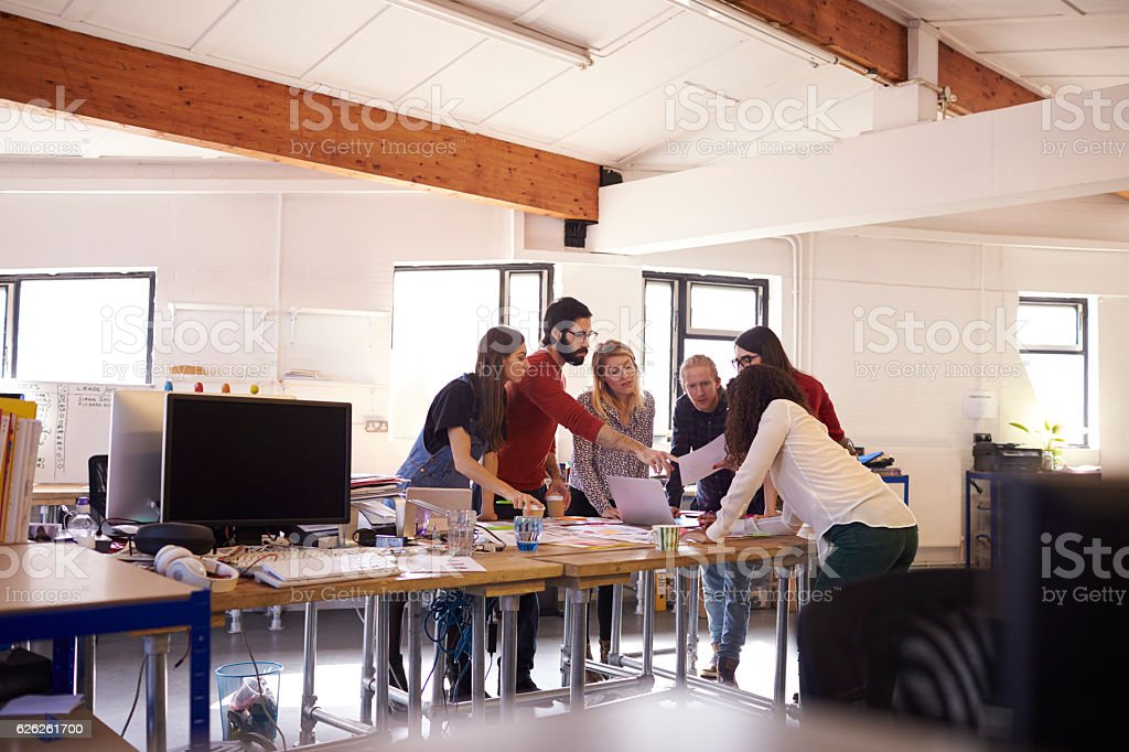 Wide Angle Shot Of Designers Brainstorming In Office Meeting stock photo