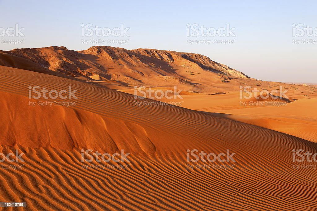 Wide angle shot of empty sand dunes at sunset royalty-free stock photo
