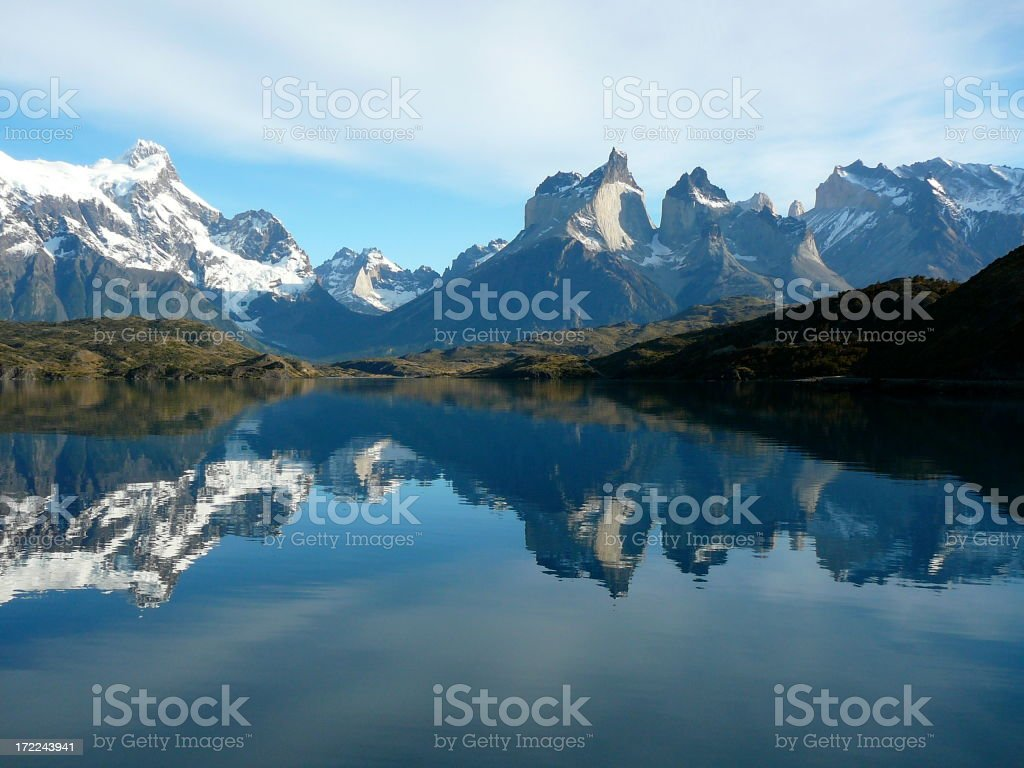 Wide angle shot of still lake reflecting Torres del Paine stock photo