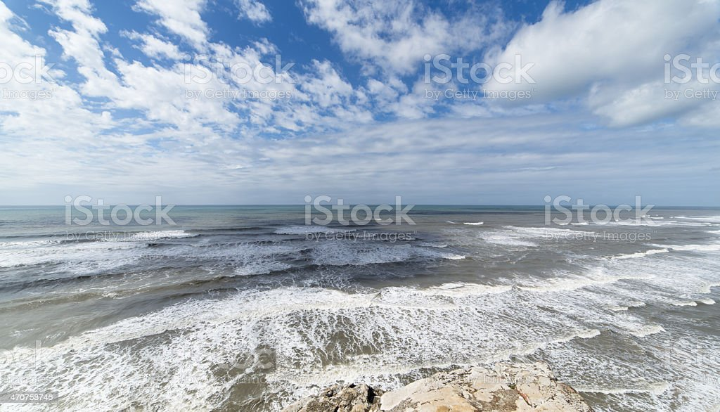 Wide angle view of ocean and cloud sky stock photo