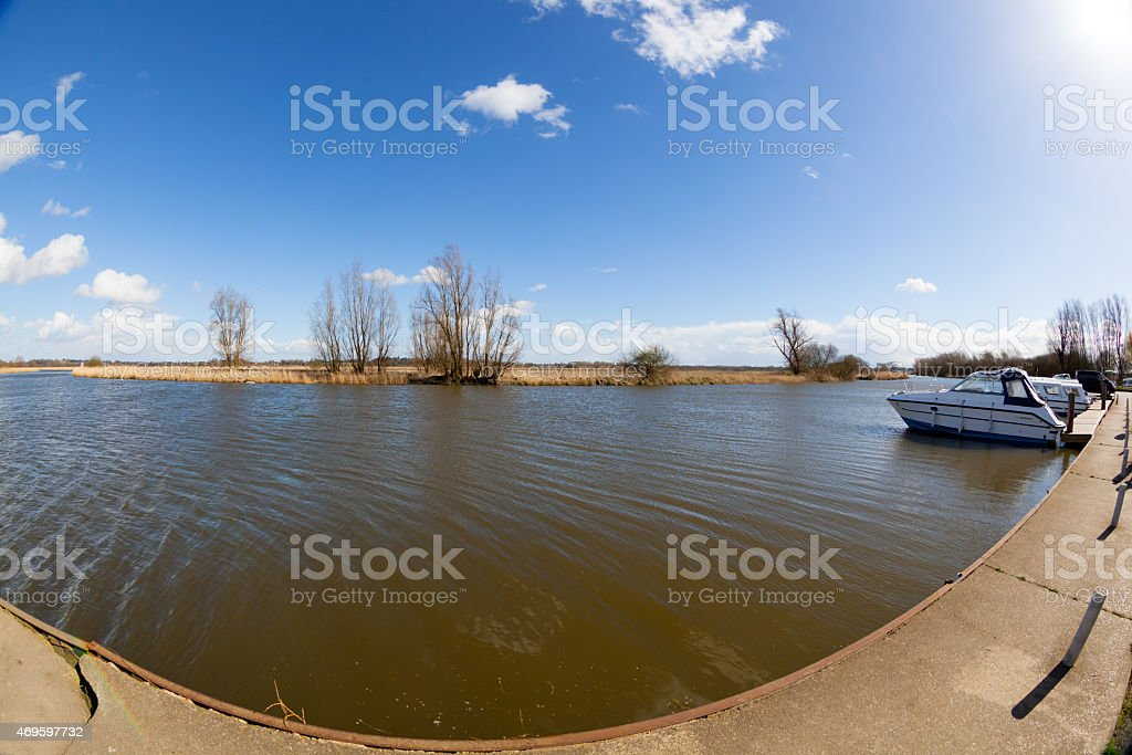 wide angle view river sky trees and marina suffolk england stock photo