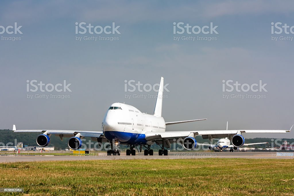 Wide body passenger aircraft taxiing on the main taxiway royalty-free stock photo