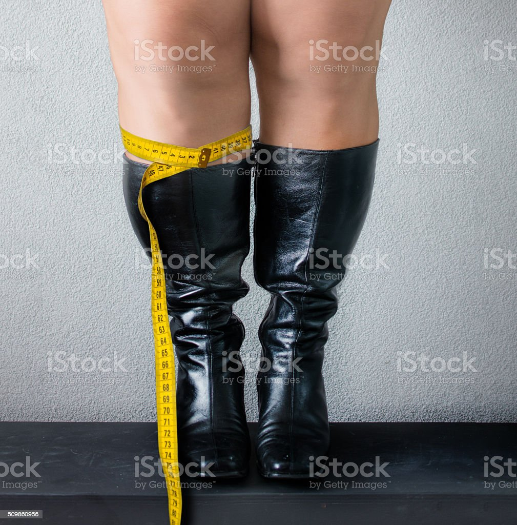 wide calf size boots with centimeter stock photo