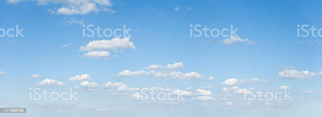 Wide cloudscape on a clear blue sky stock photo