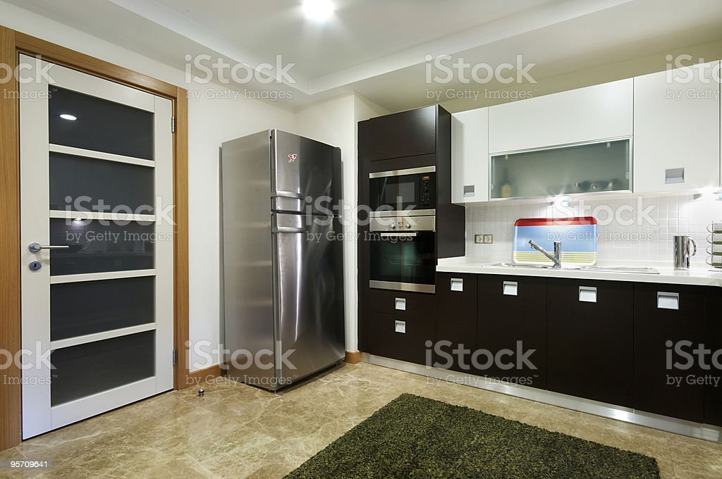 Wide Domestic Kitchen with Door royalty-free stock photo