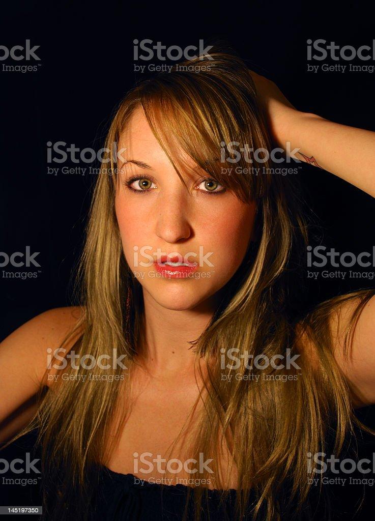 Wide eyed brunette girl against black background royalty-free stock photo
