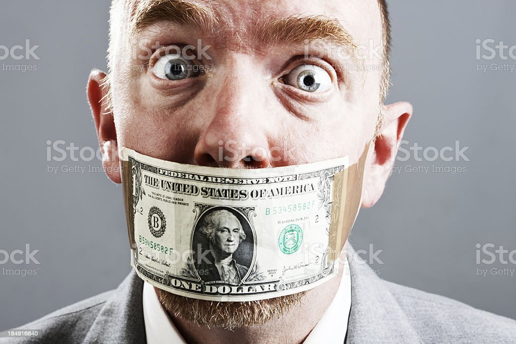 Wide eyed businessman is shocked by dollar bill gag stock photo