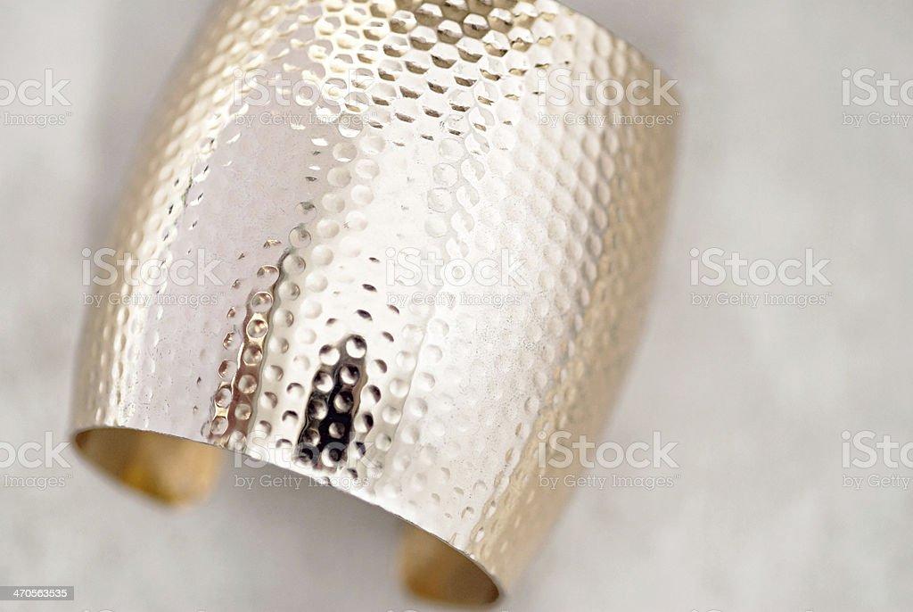 Wide Gold Bangle Bracelet stock photo