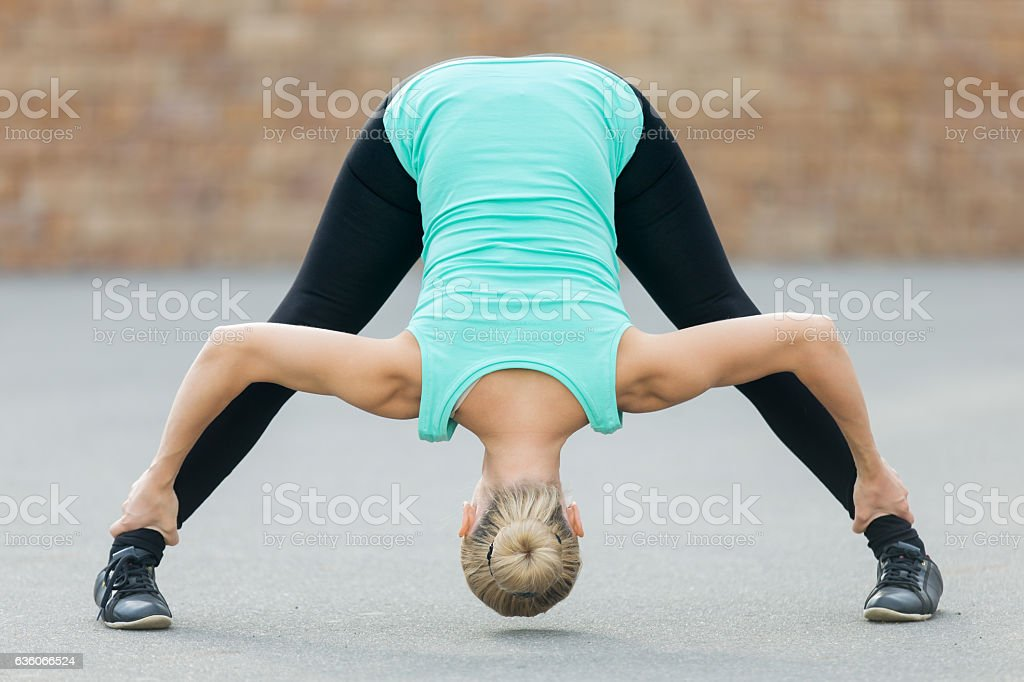 Wide Legged Forward Bend pose stock photo