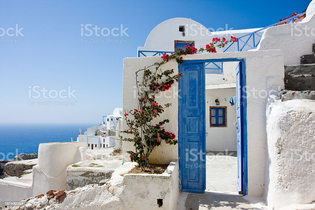wide open blue door and bougainvillea royalty-free stock photo