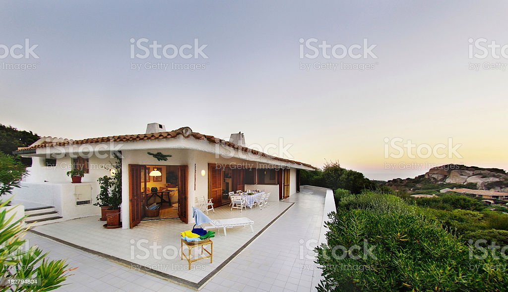 Wide open white terrace of a beautiful seaside house, Sardinia royalty-free stock photo