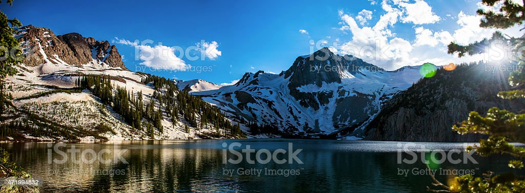 Wide Panorama Colorado Mountain Snowmass Lake Sun Flare stock photo