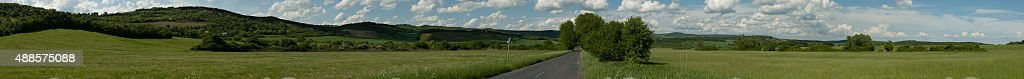 Wide panorama of an hilly rural countryside stock photo