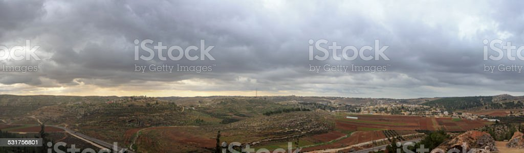 Wide panorama of Palestinian villages before storm at Har Hebron stock photo