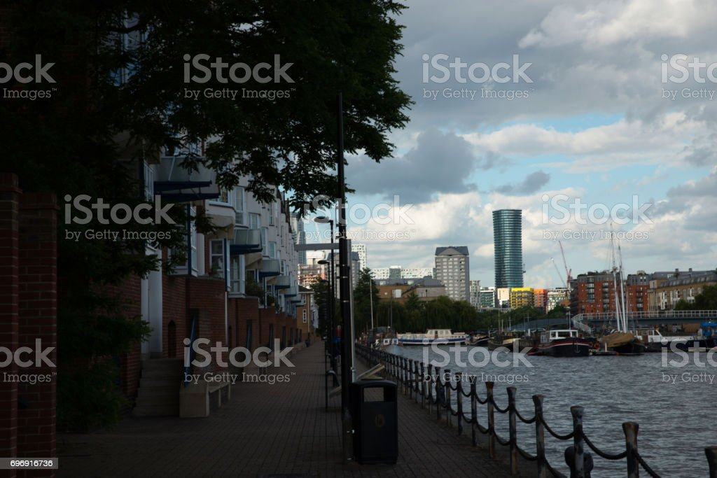 Wide river canal, view of residential buildings on the other side of the shore, cityscape, beautiful district stock photo