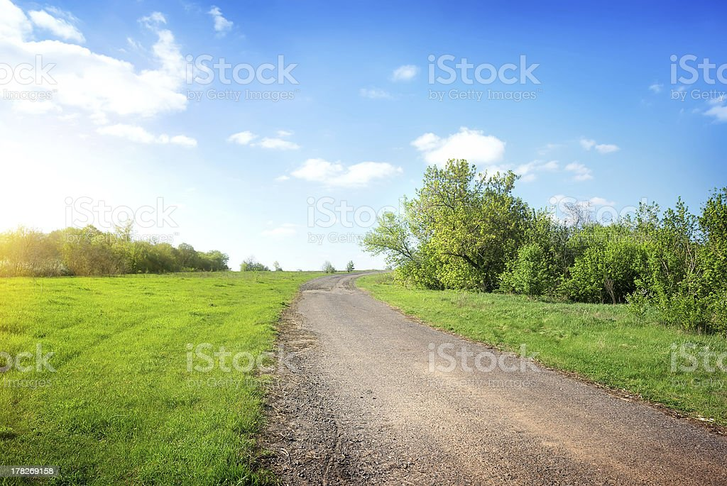 Wide road in the field royalty-free stock photo