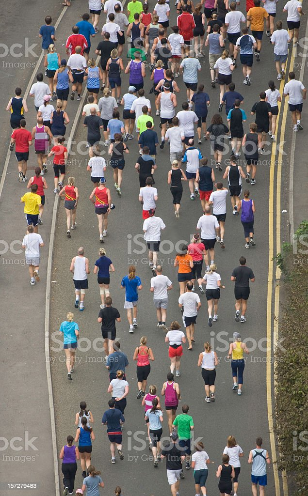 A wide shot from above of people running in a competition stock photo