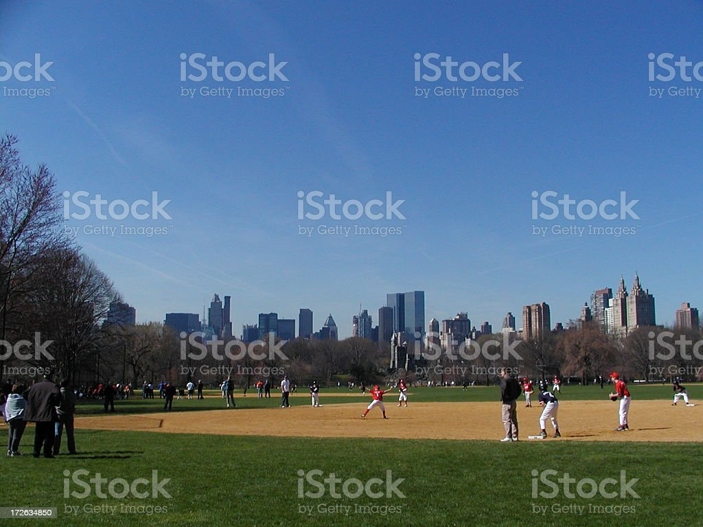 Wide shot of a baseball game in Central Park royalty-free stock photo