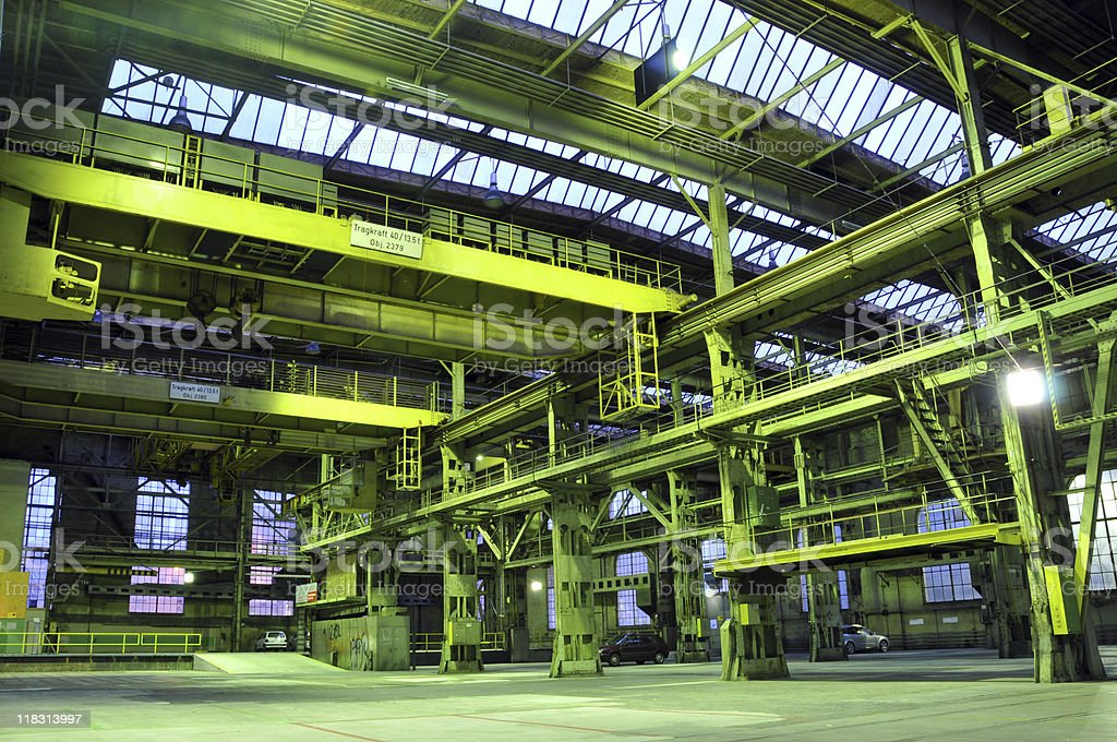 Wide shot of a factory hall with highlighted yellow color stock photo