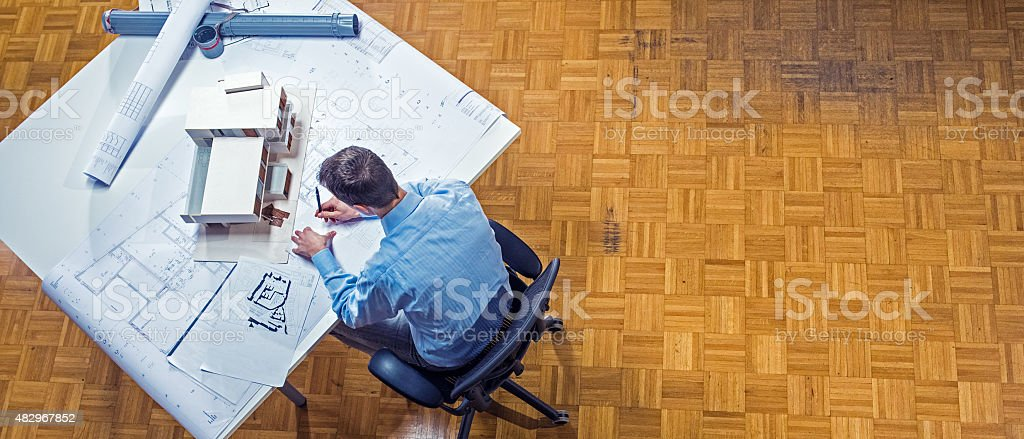 Wide shot of architect working in office stock photo