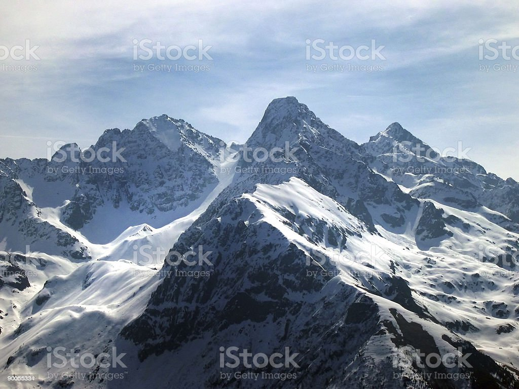 A wide shot of snow covered mountains royalty-free stock photo