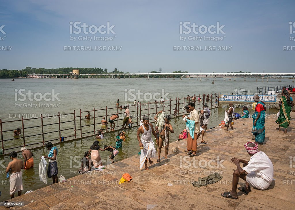 Wide view Cauvery River and ritual bathers. stock photo