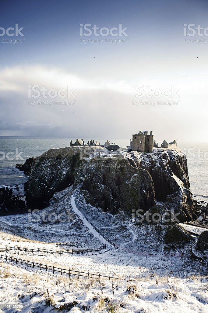 Wide View in Snow - Dunnottar Castle, Stonehaven, Scotland UK stock photo