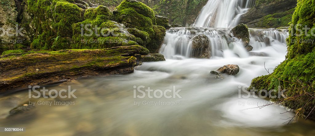 Wide View Of A Flowing Waterfall In North Yorkshire Forest. stock photo