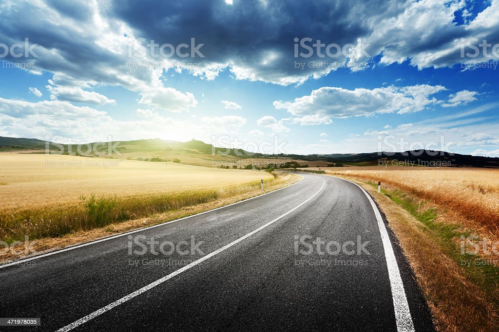 Wide view of an asphalt road in Tuscany, Italy stock photo