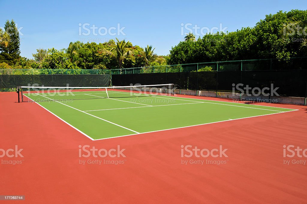 Wide view of an empty tennis court stock photo