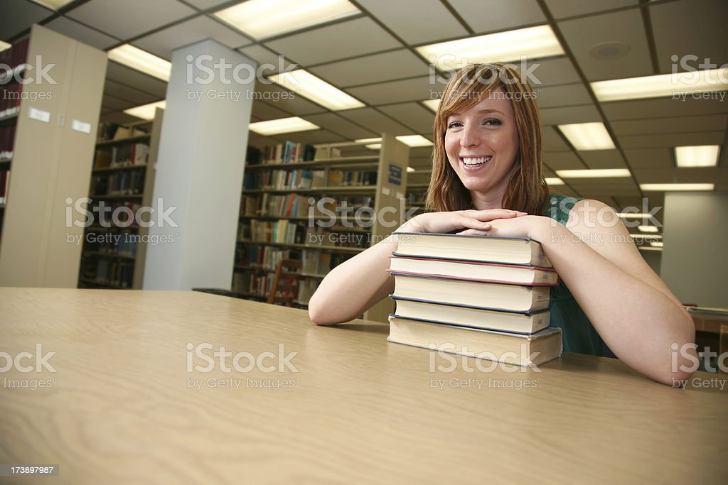 Wide View of Happy Female College Girl in the Library royalty-free stock photo