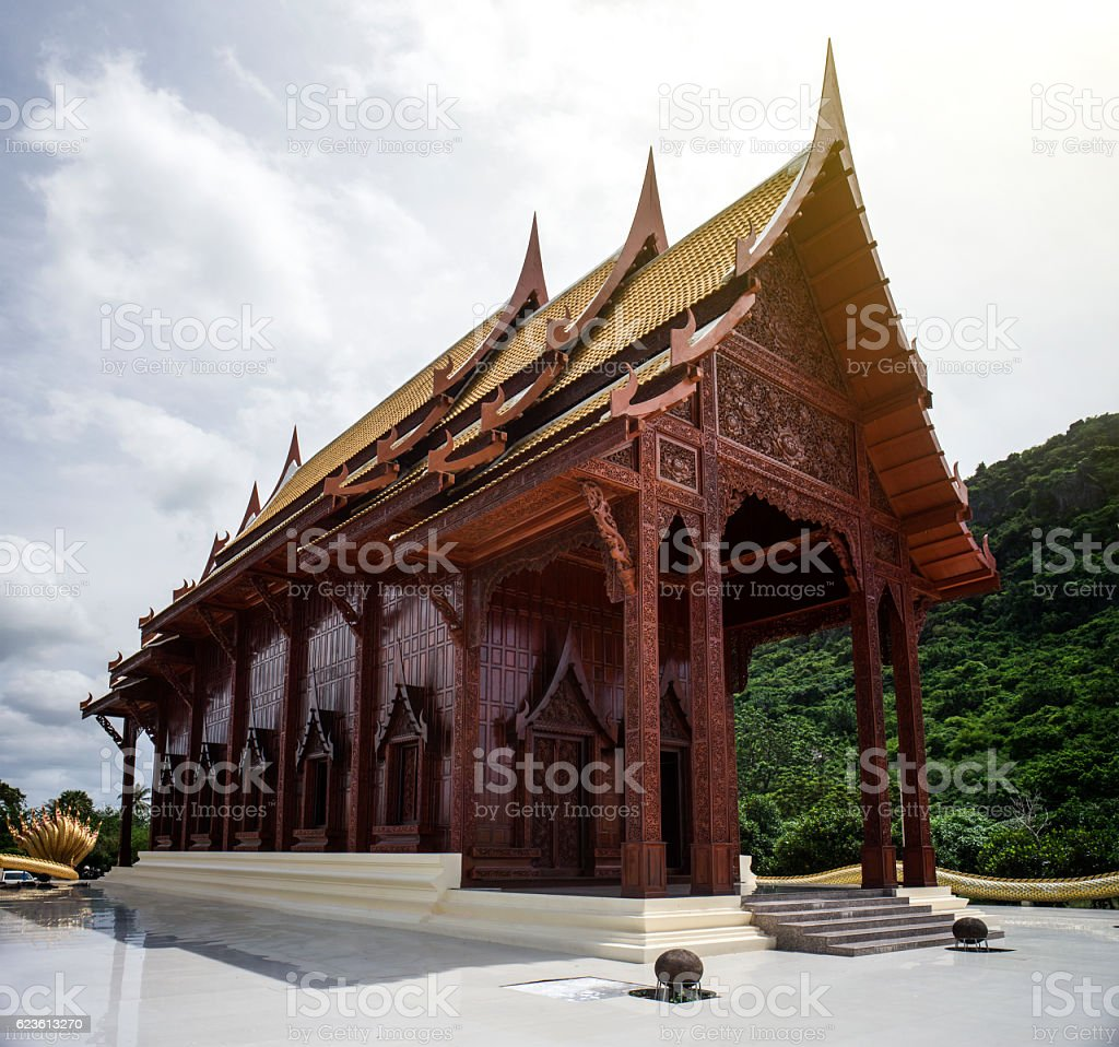 wide view of thai beautiful wooden temple,thai style carving stock photo