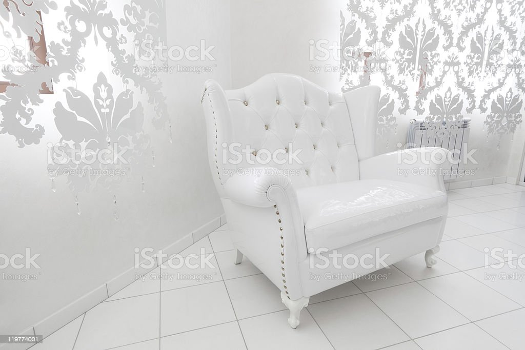 wide white armchair stock photo